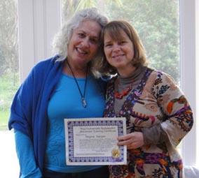 Susan Aaron gives Regina her graduation Certificate